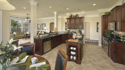 Kitchen and Breakfast Room - The Savannah Model in Bryan Design Center Tilson Custom Home Photo