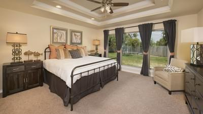 Master Bedroom - The Guadalupe Model in San Marcos Design Center Tilson Custom Home Photo