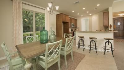 Dining Area and Kitchen - Crockett Model in McKinney Tilson Custom Home Photo