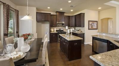 Kitchen and Dining Area - The Guadalupe Model in San Marcos Design Center Tilson Custom Home Photo