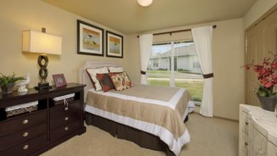Bedroom 2 - Marian Model in Bryan Design Center Tilson Custom Home Photo
