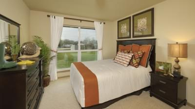 Bedroom 3 - Marian Model in Bryan Design Center Tilson Custom Home Photo