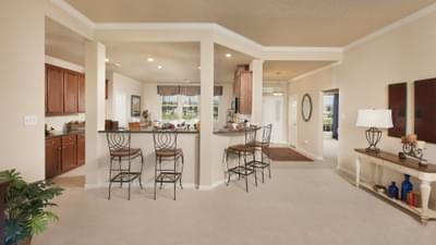 Family Room and Kitchen - Nueces Model at Spring Design Center Tilson Custom Home Photo