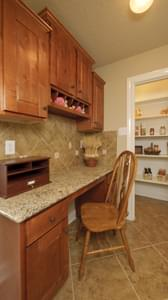 Kitchen Desk Area and Pantry - The Palacios Model in the Angleton Design Center Tilson Custom Home Photo