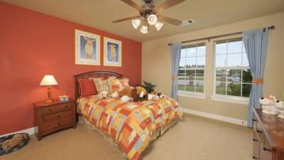 Bedroom 2 - The Palacios Model in the Angleton Design Center Tilson Custom Home Photo