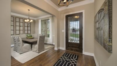 Foyer and Dining Room - The Rockwall Model in McKinney Design Center Tilson Custom Home Photo
