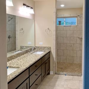 Alternate Master Bath with Walk In Shower - The San Felipe | Customer Home in Comal County - May Contain Upgrades and Plan Changes Tilson Custom Home Photo
