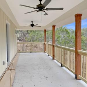 Extended Rear Covered Porch - The San Felipe | Customer Home in Comal County - May Contain Upgrades and Plan Changes Tilson Custom Home Photo