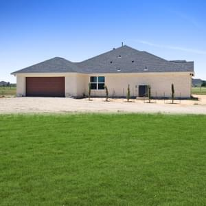 Attached 2-Car Garage - The Shiloh | Customer Home in Brazoria County - May Contain Upgrades and Plan Changes Tilson Custom Home Photo