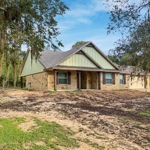 Elevation C with attached Front Load Garage – The La Porte | Customer Home in Brazoria County - May Contain Upgrades and Plan Changes Tilson Custom Home Photo