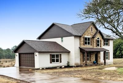 Elevation C with Attached Side Load Garage – The Hansford | Customer Home in Hays County - May Contain Upgrades and Plan Changes Tilson Custom Home Photo