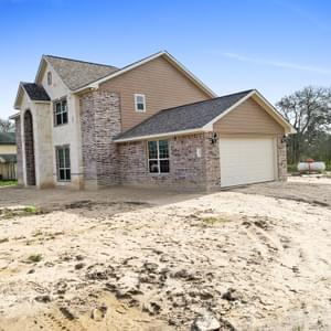 Elevation B with Attached Side Load Garage – The Hansford | Customer Home in Chambers County - May Contain Upgrades and Plan Changes Tilson Custom Home Photo