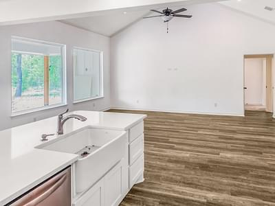 Farmhouse Sink with Custom Island - The Magnolia   Customer Home in Guadalupe County - May Contain Upgrades and Plan Changes Tilson Custom Home Photo