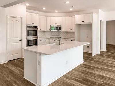 Kitchen with Custom Island - The Magnolia   Customer Home in Guadalupe County - May Contain Upgrades and Plan Changes Tilson Custom Home Photo