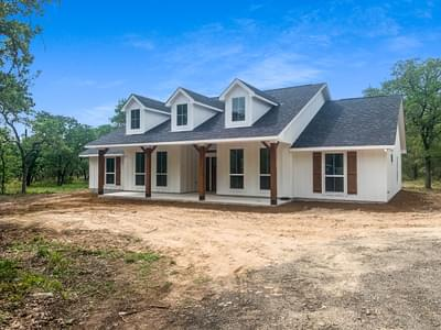 Elevation C with Board & Batten Siding - The Magnolia | Customer Home in Guadalupe County - May Contain Upgrades and Plan Changes Tilson Custom Home Photo