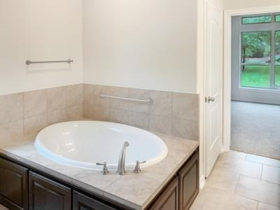 Master Bath tub - The Oxford | Customer Home in Walker County - May Contain Upgrades and Plan Changes Tilson Custom Home Photo