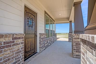 Covered Front Porch - The Rio | Customer Home in Burnet County - May Contain Upgrades and Plan Changes Tilson Custom Home Photo