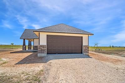 Optional Attached 2-Car Side Load Garage - The Rio | Customer Home in Burnet County - May Contain Upgrades and Plan Changes Tilson Custom Home Photo