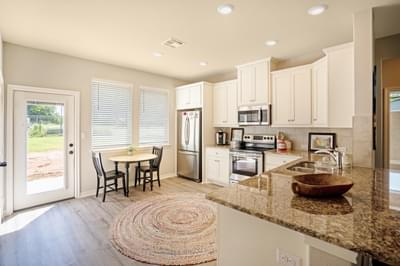 Kitchen – The San Antonio | Customer Home in Llano County - May Contain Upgrades and Plan Changes Tilson Custom Home Photo