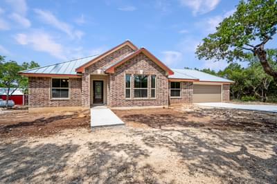 Elevation B with Attached Front Load Garage – The La Porte | Customer Home in Williamson County - May Contain Upgrades and Plan Changes Tilson Custom Home Photo