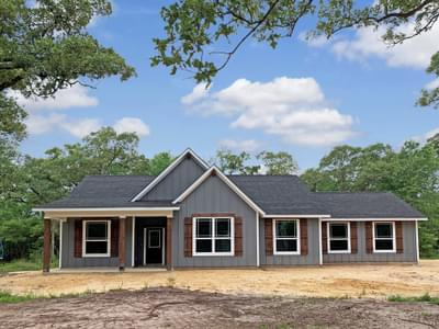 Elevation C  with Attached Side Load Garage – The La Porte | Customer Home in Grimes County - May Contain Upgrades and Plan Changes Tilson Custom Home Photo