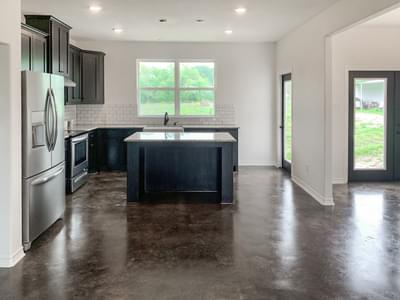 Alternate Kitchen Island – The Harrisburg | Customer Home in Milam County - May Contain Upgrades and Plan Changes Tilson Custom Home Photo