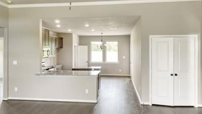 Living with raised ceiling, Dining, Kitchen – The Harrisburg | Customer Home in Leon County - May Contain Upgrades and Plan Changes Tilson Custom Home Photo