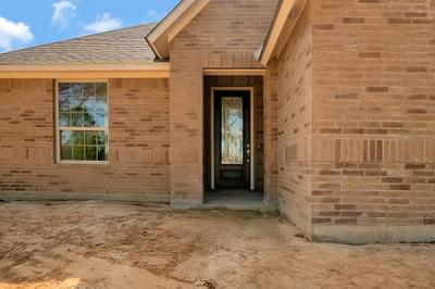Front Porch – The Angelina | Customer Home in Brazoria County – May Contain Plan Changes and Upgrades Tilson Custom Home Photo