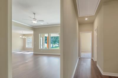 Hall 2 and Family Room – The Angelina | Customer Home in Brazoria County – May Contain Plan Changes and Upgrades Tilson Custom Home Photo