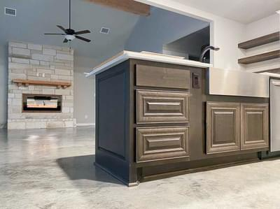 Kitchen and Living – The Angelina | Customer Home in Liberty County – May Contain Plan Changes and Upgrades Tilson Custom Home Photo