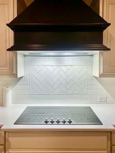 Range Hood and Backsplash – The Angelina | Customer Home in Liberty County – May Contain Plan Changes and Upgrades Tilson Custom Home Photo