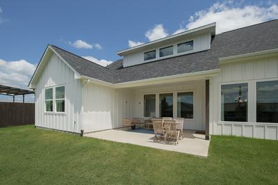 Rear Uncovered Porch - Canyon Model in Bryan Tilson Custom Home Photo