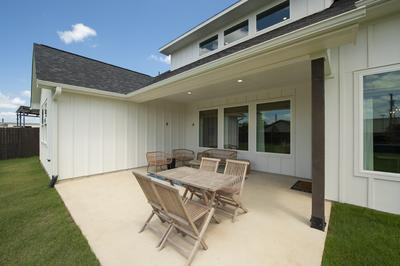 Rear Uncovered and Covered Porch - Canyon Model in Bryan Tilson Custom Home Photo