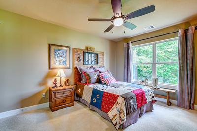 Bedroom 2 - The San Jacinto Model in Spring Design Center Tilson Custom Home Photo