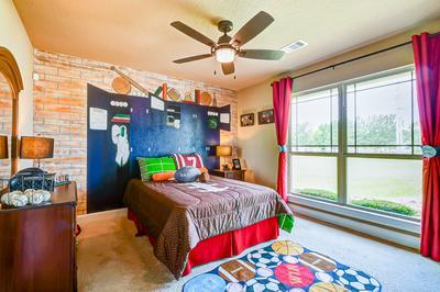 Bedroom 3 - The San Jacinto Model in Spring Design Center Tilson Custom Home Photo