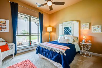 Bedroom 4 - The San Jacinto Model in Spring Design Center Tilson Custom Home Photo